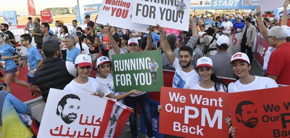 El primer ministro libanés asegura desde Riad que volverá «muy pronto»