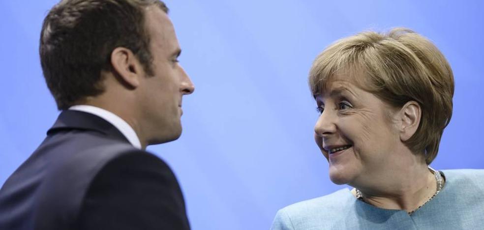 Merkel y Macron lideran la lucha contra el cambio climático ante la huida de Trump