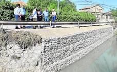 Un muro de mampostería reduce el peligro junto a la acequia en Nonduermas