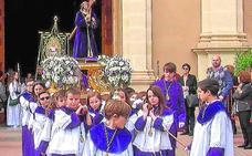 El pregón del exalcalde Coronado y una gran procesión infantil abren la Semana Santa torreña