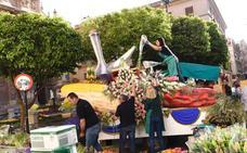 El reparto del millón de flores se hará hoy en la Alameda de Colón