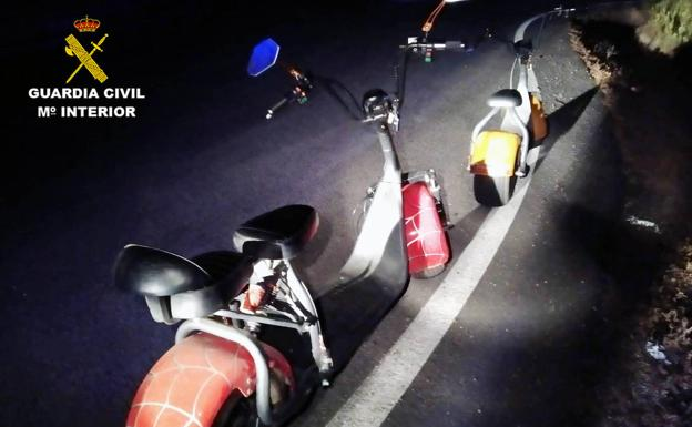 Scooters on the highway.